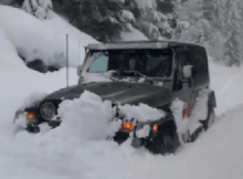 Jeep in deep snow